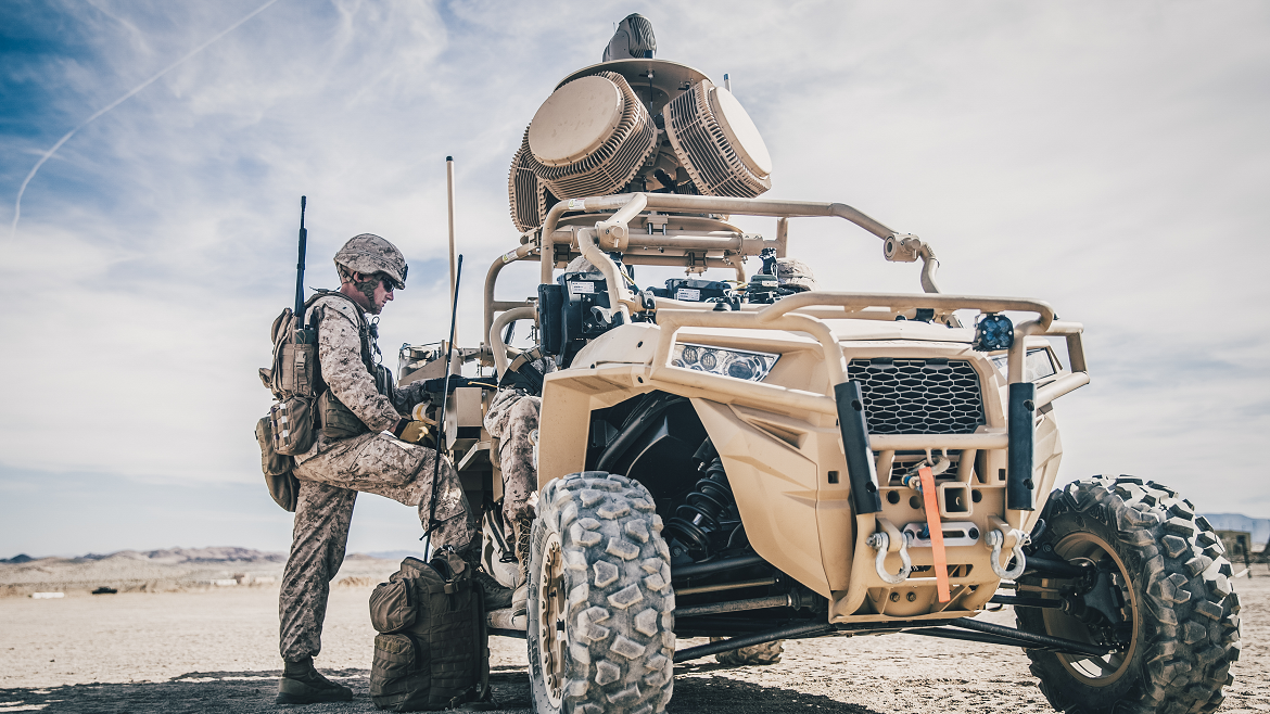 Marine standing next to the LMADIS counter-unmanned aircraft system in California (Photo Credit: Lance Cpl. Dalton S. Swanbeck, USMC).