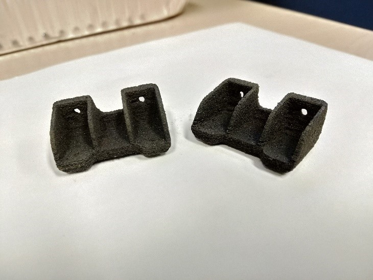 Figure 7: Reduced Scale (0.5x), Selective Laser- Sintered Brackets With High Service Temperature Capabilities (300 °C) (Source: AFRL).